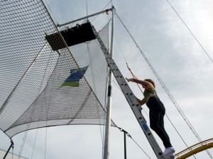 Lucy climbs the ladder to the Trapeze platform