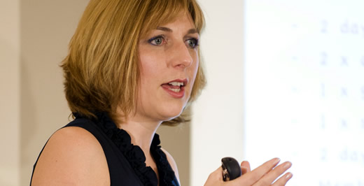 Image of Lucy speaking at an event