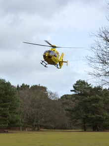Dorset & Somerset Air Ambulance taking off from Brownsea Island