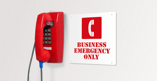 Red Business Emergency phone hanging on wall