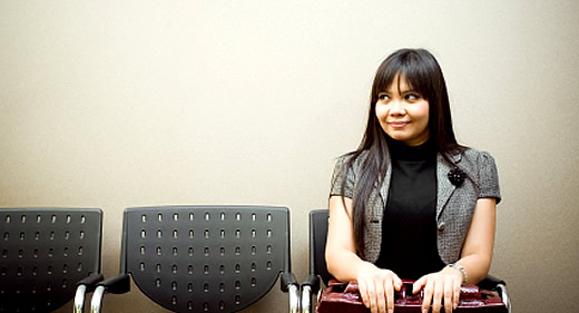 Image of woman waiting in waiting room