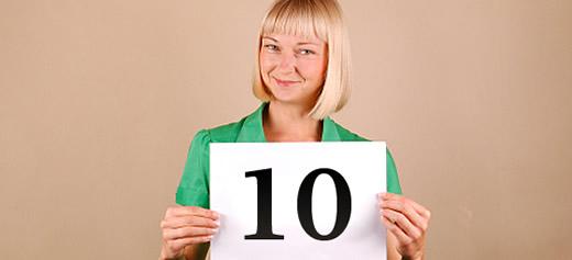 Woman holding up a 'ten' score