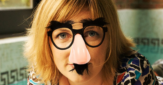 Lucy wearing comedy glasses and moustache
