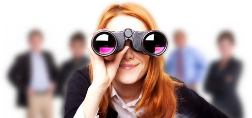 Woman looking with binoculars, with out-of-focus people behind her