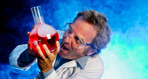 Crazy mad scientist with a chemical reaction in a flask