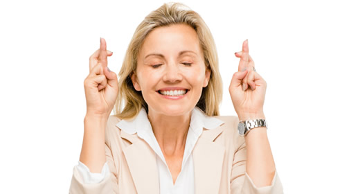 Mature businesswoman holding fingers crossed isolated on white background