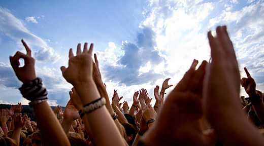 Raised hands in adulation