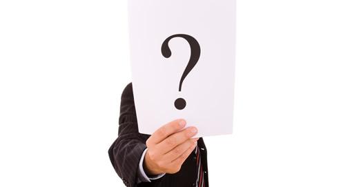 businessman hiding behind the question mark