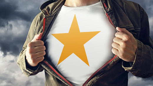 Man opening shirt to reveal superhero starred vest