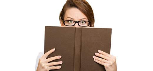 Closeup portrait woman with glasses hiding her face behind book