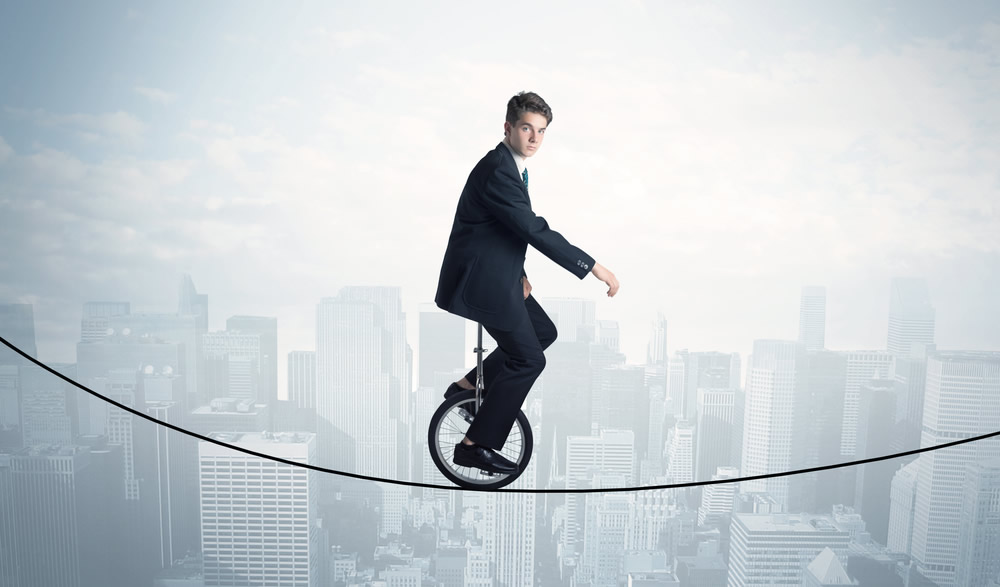 Suited man on unicycle