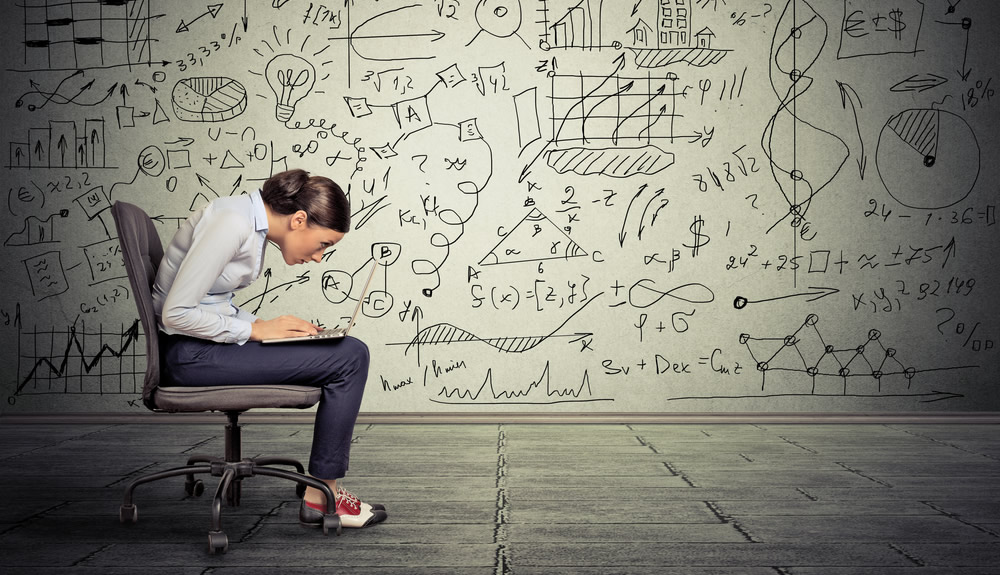 Woman at laptop with complicated formula