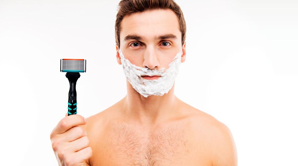 Man with many-bladed razor